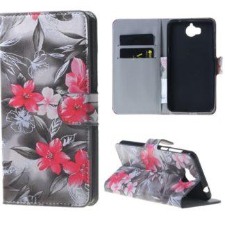 fodral till y6 2017 i svartvit med rosa blommor, fungerar som plånbok med kortplatser och sedelficka
