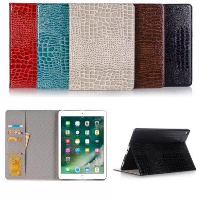 plånbok fodral med kortplatser till ipad air och ipad 2017 och 2018. Finns i 5 olika färger och har ett krokodilmönster